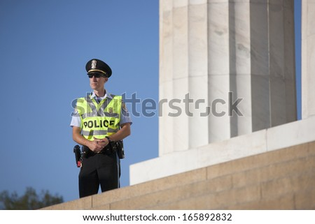 policeman walks in front of statue for Lincoln at the 50th Anniversary of the march on Washington and Martin Luther King's Speech, August 24, 2013, Lincoln Memorial, Washington, D.C.