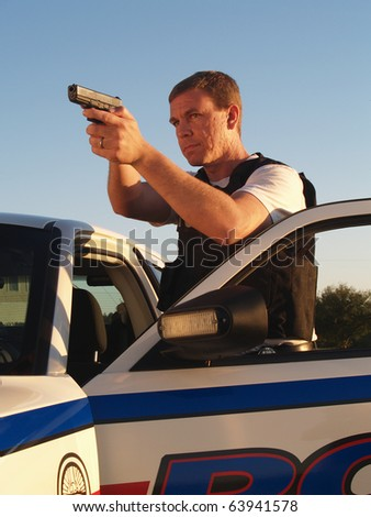 Policeman with Weapon Drawn - stock photo