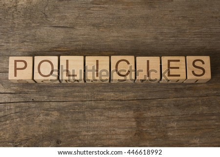 Policies word written on wooden cubes - stock photo