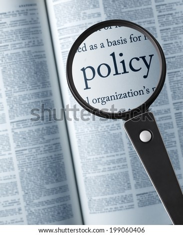 """policy/ Magnifying glass on the""""policy"""" in dictionary - stock photo"""