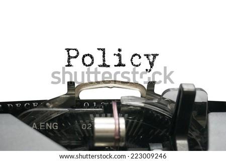 Policy on typewriter - stock photo