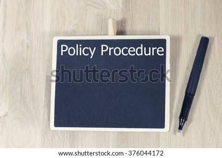 policy procedure is written on the board. Business Concept - stock photo