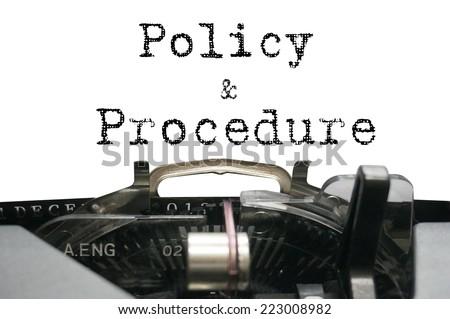 Policy & Procedure on typewriter - stock photo