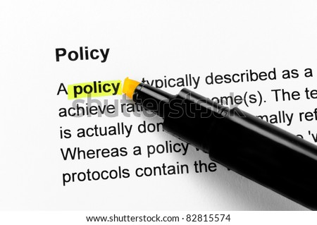 Policy text highlighted in yellow, under the same heading - stock photo