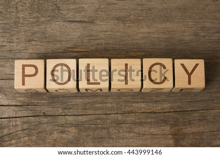 POLICY word on a wooden cubes - stock photo