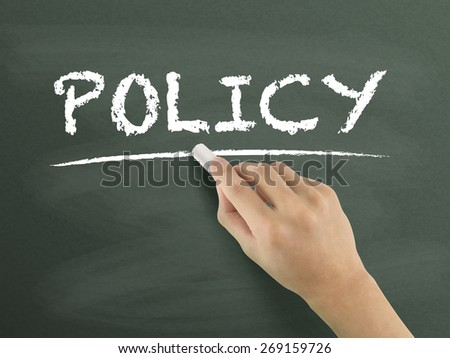 policy word written by hand on blackboard - stock photo