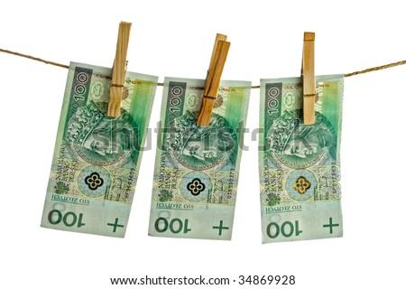 polish banknotes hundred on string - stock photo