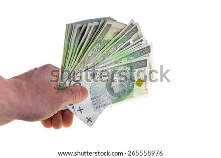 Polish currency banknotes hundred zloty stacked in hand.