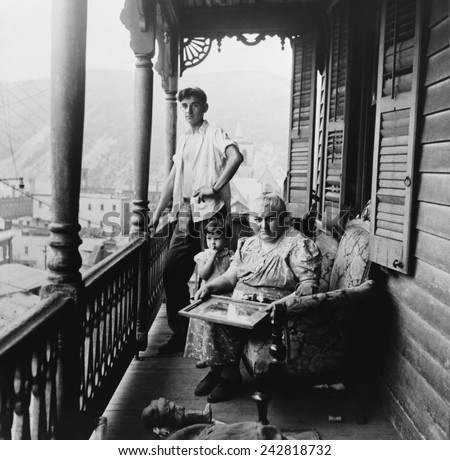 Polish family on the balcony of their apartment on High Street in Mauch Chunk, Pennsylvania. August 1940 photograph by Jack Delano.