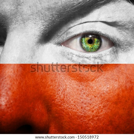 Polish flag painted on mans face to support his country Poland