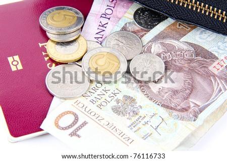 Polish money and a passport. - stock photo