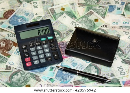 Polish money, calculator, pen and wallet on money background - stock photo