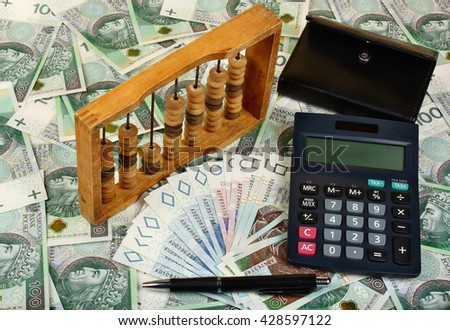 Polish money, calculator, pen, wallet and abacus - stock photo