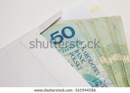 Polish money in an envelope as a bribe - stock photo