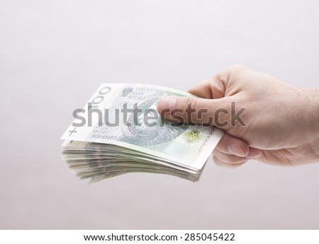 Polish money in hand - stock photo