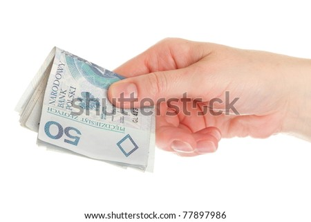 Polish money isolated on white in hand - stock photo