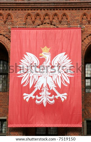Polish national flag hanging on an old Gothic wall - stock photo