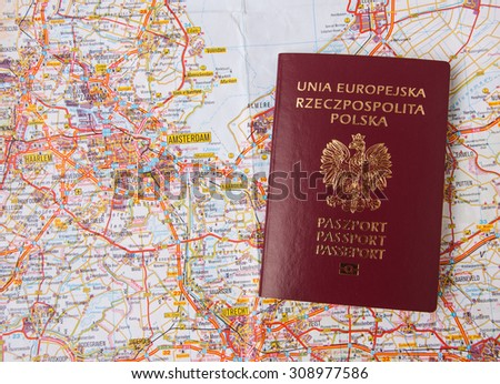 Polish passports isolated on map background - stock photo