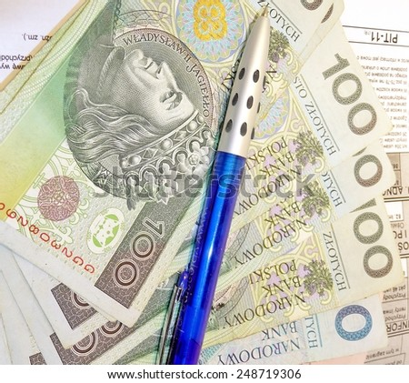 Polish tax form (PIT-11) and Polish money - settlement with the Tax Office, - stock photo
