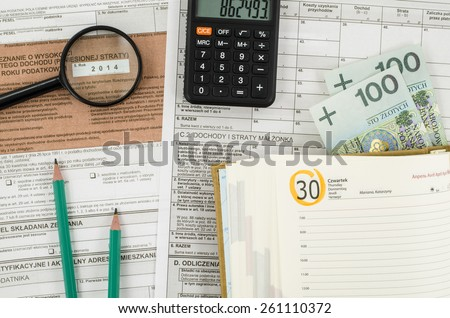 Polish tax form with office tools - stock photo