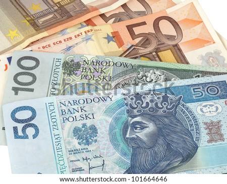 polish zloty and euro bills - stock photo
