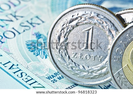 Polish zloty coins over banknote background - stock photo