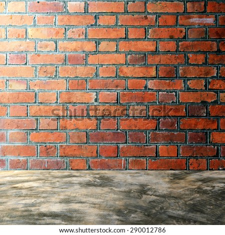 Polished bare concrete floor and red brick wall texture background