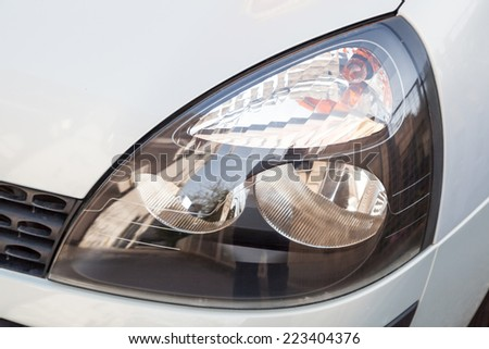 Polished car headlight - stock photo