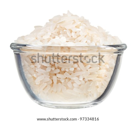 Polished long rice heap in small glass bowl, isolated on white - stock photo
