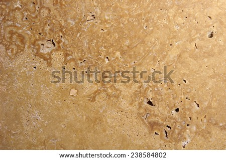 Polished stone closeup on wall  in sunny day  - stock photo