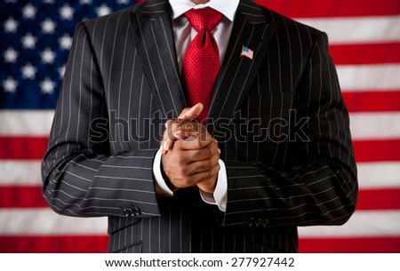 Politician: Man with Hands Clasped - stock photo