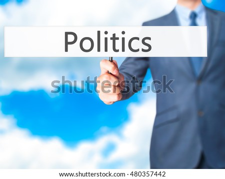 Politics - Business man showing sign. Business, technology, internet concept. Stock Photo