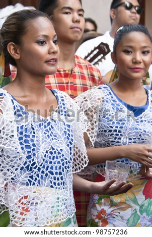 """POLIZZI GENEROSA, SICILY - AUGUST 21: Woman of Philippine folk group at the International """"Festival of hazelnuts"""",dance and parade through the city: August 21, 2011 in Polizzi Generosa,Sicily, Italy - stock photo"""
