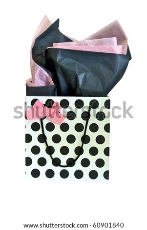 Polka dot gift bag with pink bow and pink and black tissue paper - stock photo