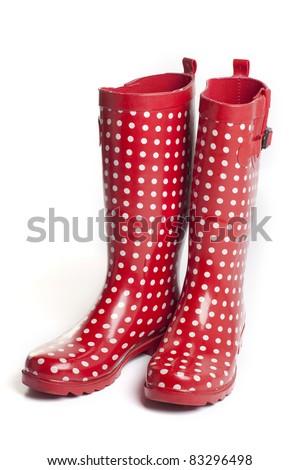 Polka dot red rain boots on white background - stock photo