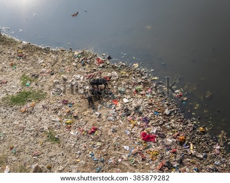 Polluted river banks - stock photo