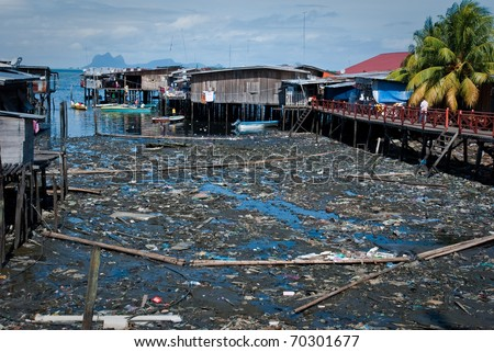 Polluted town in Malaysia, garbage near the houses - stock photo