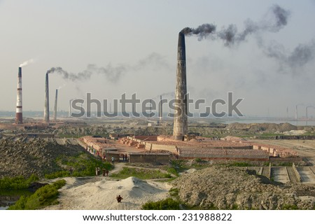Polluting air pipes of brick factories in Dhaka, Bangladesh. - stock photo