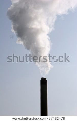 polluting fumes and smoke from industrial chemical site - stock photo