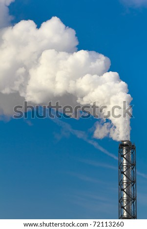 Polluting white smoke coming out of chimney - stock photo