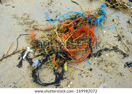 Pollution at the beach nets and cords - stock photo