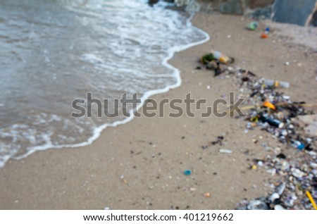 Pollution on the beach with blurred background - stock photo