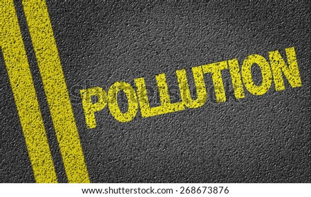 Pollution written on the road - stock photo
