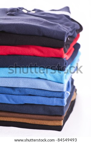 Polo shirts various colours isolated - stock photo
