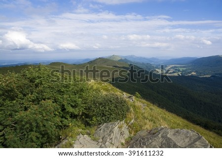 Polonina Wetlinska (Carpathian mountain pasture) in Bieszczady Mountains, Poland, mountain hostel called in Polish - Chatka Puchatka - in the distance - stock photo