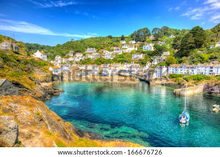 Polperro harbour Cornwall England with clear blue and turquoise sea in vivid colour HDR like painting   - stock photo