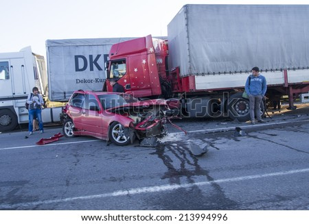 POLTAVA OBLAST, UKRAINE - Aug 29, 2014:Car accident involving a truck on the highway E40 in Poltava, Ukraine - stock photo