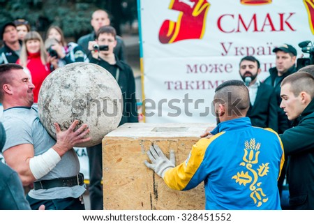 POLTAVA, UKRAINE - 17 OCTOBER 2015: locals contemplate the competition of tournament of the strongest men of country on Strongman event