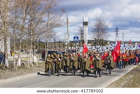 Polyarnye Zori ,Russia - MAY 09, 2016: Polyarnye Zori celebrates 71-th Victory Day anniversary. Immortal Regiment marches on - stock photo