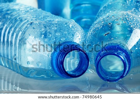 Polycarbonate plastic bottle of mineral water isolated on white background - stock photo